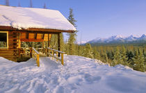 USFS Schnauss Cabin rental in Winter ovelooking peaks in Glacier National Park in winter by Danita Delimont