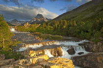 Morning light greets Swiftcurrent Falls in the Many Glacier Valley of Glacier National Park in Montana by Danita Delimont
