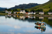 Beautiful photo of small village of Dornie with reflections and boat in Western Highlands Scotlands by Danita Delimont