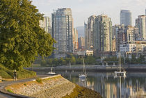 Cyclist along the Seawall Trail in downtown Vancouver British Columbia by Danita Delimont
