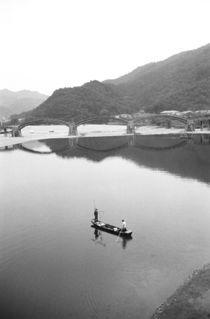 Fishermen and historic bridge by Danita Delimont