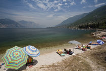 Lake Garda beachgoers by Danita Delimont
