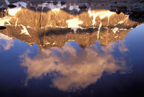 The Ramparts (3040 meters) viewed in reflection by Danita Delimont