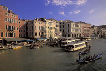 Boat traffic by Rialto Bridge by Danita Delimont