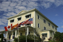 Flags fly in front of Rossmount Inn by Danita Delimont