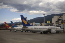 Domestic Chinese jet airliners lined up at departure gates at Lijiang Airport by Danita Delimont