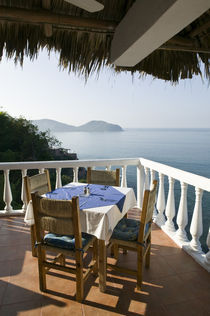 Cafe Table over Zihuatanejo Bay by Danita Delimont