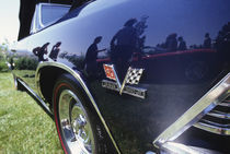 Reflection of 1997 Chevrolet Stingray in 1969 Chevrolet Malibu convertible by Danita Delimont