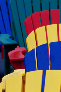 Colorful adirondack chairs by Danita Delimont