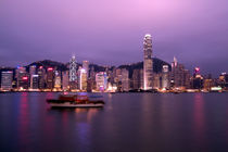 City skyline and Victoria Harbor at night by Danita Delimont