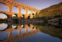 Roman aqueduct/bridge in sunset light by Danita Delimont