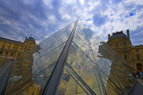 Clouds reflect off the Louvre Museum by Danita Delimont