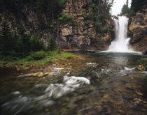 Running Eagle Falls aka Trick Falls in the Two Medicine Valley of Glacier National Park in Montana by Danita Delimont