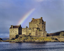 A rainbow greets visitors at Eilean Donan Castle on Loch Doich in the Highland of Scotland by Danita Delimont