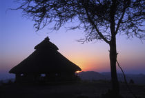 Sunset over a traditional Konso hut von Danita Delimont
