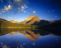 Mount Wilbur reflects into calm Fishercap Lake in Glacier National Park in Montana by Danita Delimont