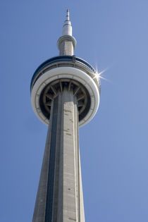 Top of CN Tower with sun star burst reflected on the top disc by Danita Delimont