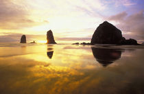 Cannon Beach Sunset with haystack and needle rocks by Danita Delimont