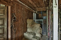 Rustic stable interior. by John Greim