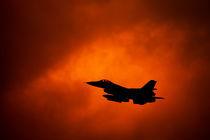 F-16 on orange sky von holka