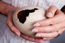 Woman holding broken ostrich egg by Sami Sarkis Photography