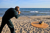 Businessman on beach with Landline Phone by Sami Sarkis Photography
