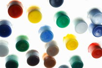 Multi-colored small plastic paint pots by Sami Sarkis Photography