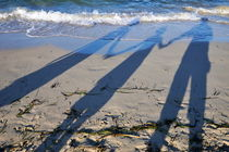 Shadow of family holding hands by Sami Sarkis Photography