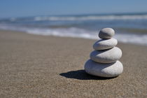 Stack of pebbles on beach by Sami Sarkis Photography