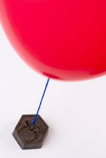 Balloon tied to weight by Sami Sarkis Photography