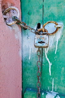 Padlock and chain on old wooden door by Sami Sarkis Photography