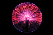 Plasma ball making electric discharges from a central electrode by Sami Sarkis Photography