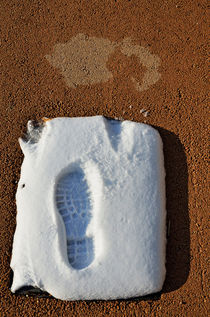 Shoe's print in snow on sidewalk by Sami Sarkis Photography