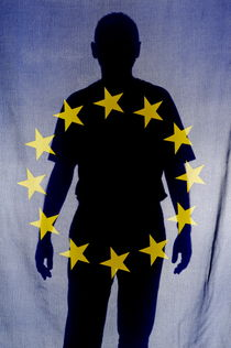Silhouette of man behind European Union Flag by Sami Sarkis Photography
