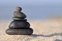 Stack of black pebbles on beach von Sami Sarkis Photography