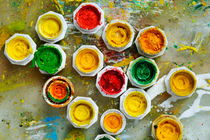 Bunch of paint tubes hoods on palette by Sami Sarkis Photography