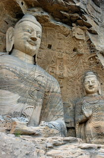 Giant Buddha statues in Yungang Shiku caves by Sami Sarkis Photography