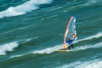 Man windsurfing in sea by Sami Sarkis Photography