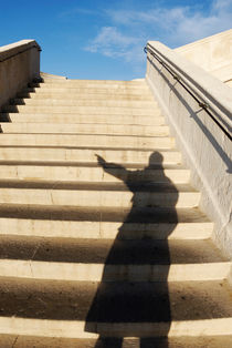 Man casting shadow on steps by Sami Sarkis Photography