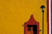 Bright yellow building facade in Valladolid by Sami Sarkis Photography