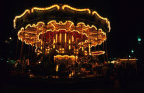 Old-fashioned carousel light up at night by Sami Sarkis Photography
