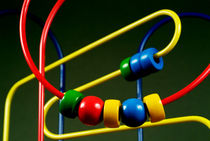Colourful toy abacus with bright beads. by Sami Sarkis Photography
