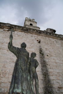 Statue of San Francisco de Asis on a brick wall near the convent on Plaza de San Francisco by Sami Sarkis Photography