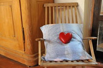 Heartshape and pillow on wooden rocking chair von Sami Sarkis Photography