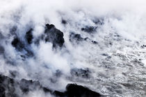 Steam rising off lava flowing into ocean by Sami Sarkis Photography