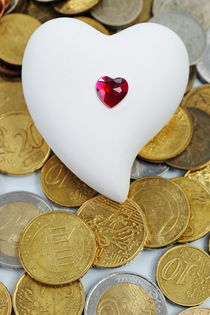 Heartshape on money by Sami Sarkis Photography