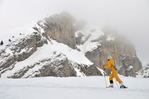 Woman snowshoeing by Sami Sarkis Photography