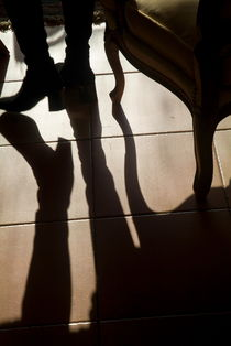 Shadow of woman's foot and furniture on floor von Sami Sarkis Photography