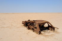 Abandoned and rusty car wreck in desert by Sami Sarkis Photography
