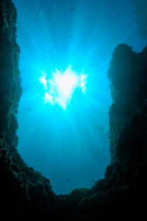 Sunbeams and rock formation underwater by Sami Sarkis Photography